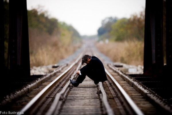 Man Sitting on a Railroad Bridge --- Image by © Richard Schultz/Corbis