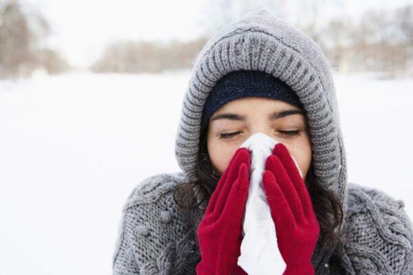 Woman using tissue