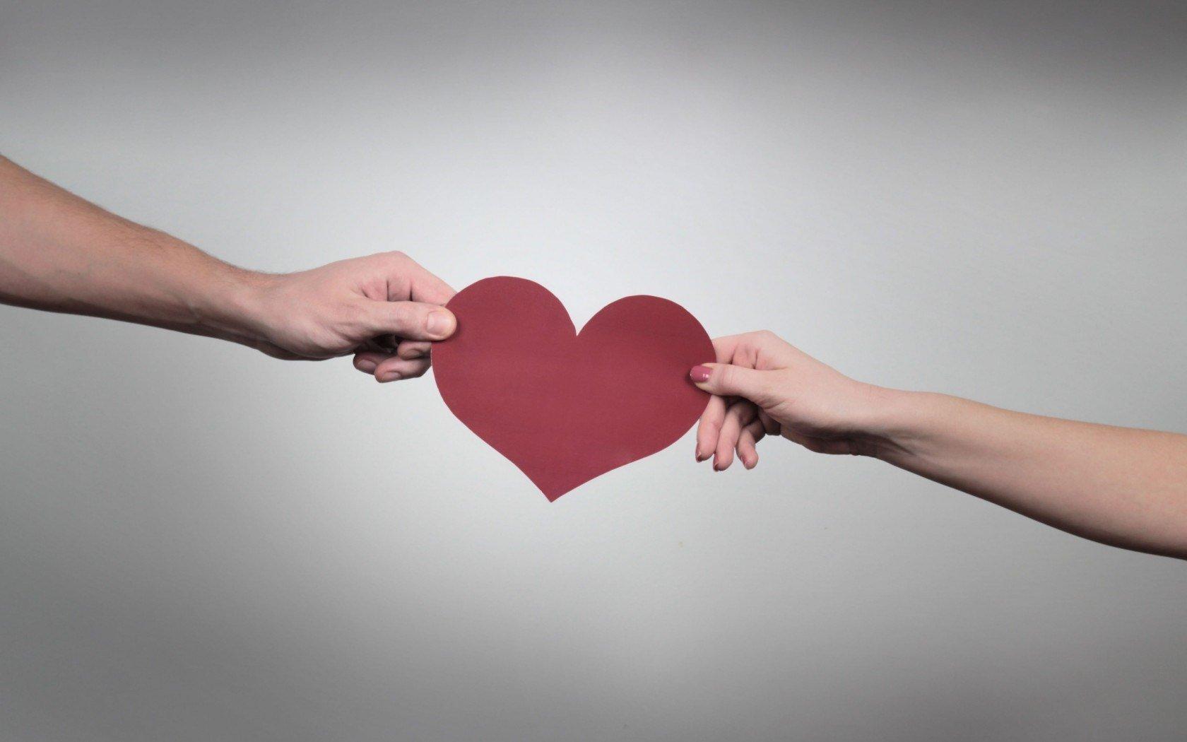 6925637-man-woman-couple-mood-heart-paper-love-feelings-hands