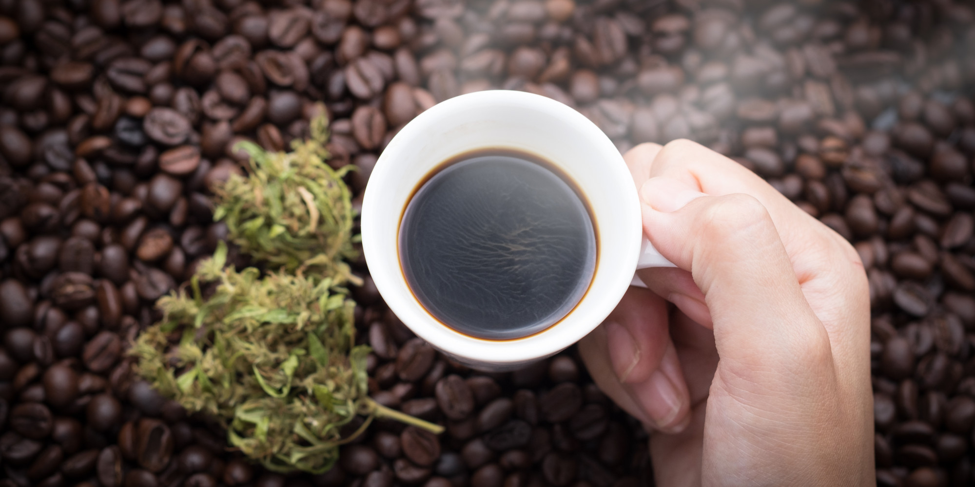 Cannabis coffee in hand