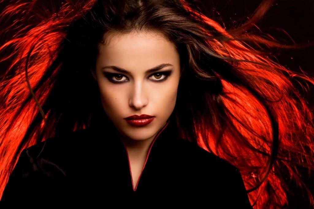 beautiful long hair young woman portait with dark makeup, studio