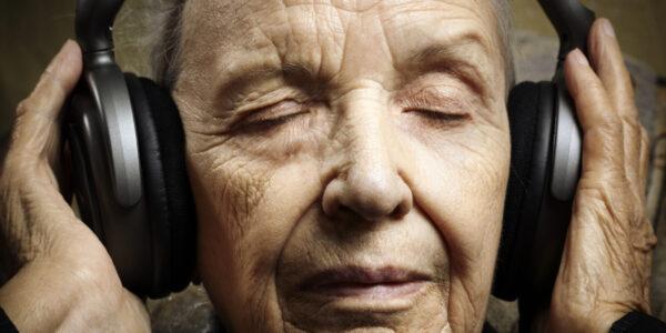 senior closeup with modern big headphones, selective focus on eyes