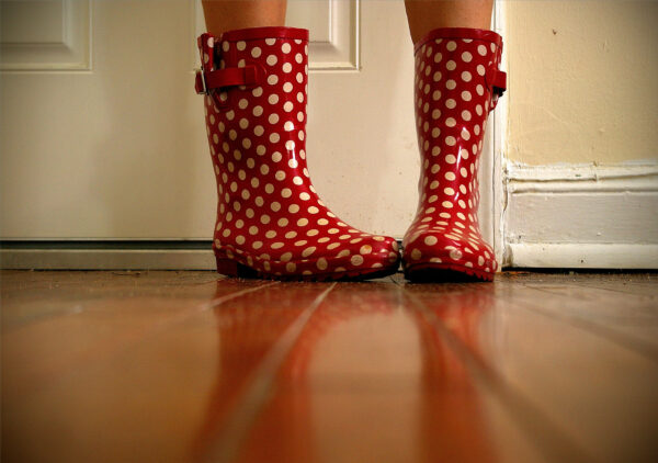 Girl wears polka-dotted rainboots